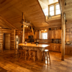 Open layout kitchen wooden walls, wooden floors, and island seating